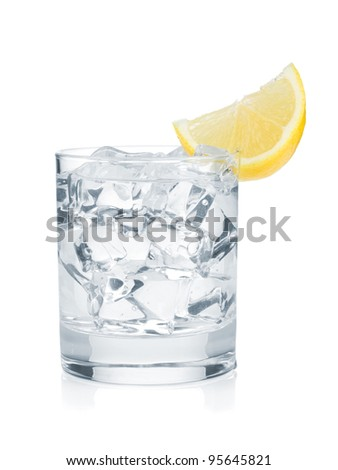 Glass of pure water with ice cubes and lemon slice. Isolated on white background