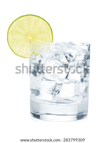 Glass of pure water with ice cubes and lime slice. Isolated on white background