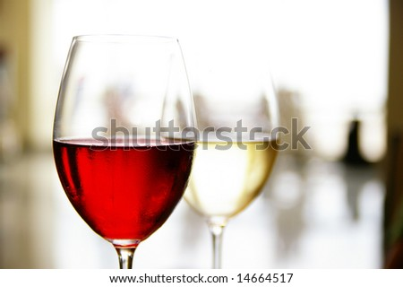 glass of red and white wine at a restaurant