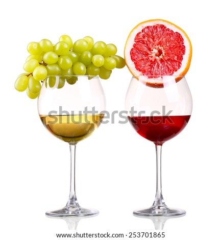 Glass of red and white wine, grape and grapefruit on a white background and with soft tenyu.Fayl includes clipping path. - stock photo