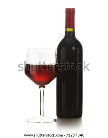 Glass of red wine and a bottle