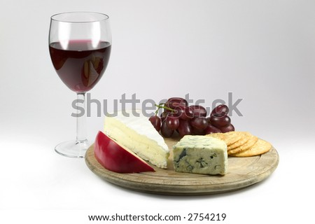 Glass of red wine and a selection of cheese and biscuits