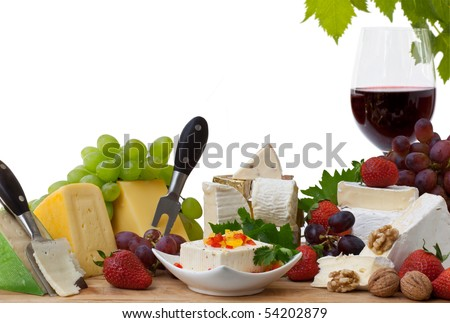 Glass of red wine and assorted cheeses with Fruit - stock photo
