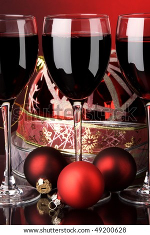 glass of red wine and Christmas decoration - stock photo