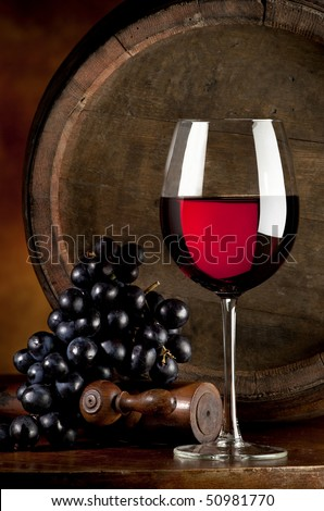 glass of red wine and cluster of grapes