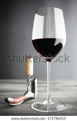 Glass of Red Wine and Corkscrew, selective focus