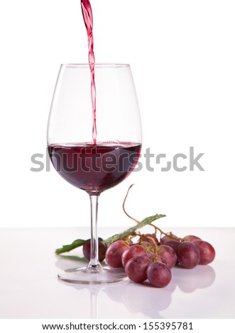 glass of red wine and grape isolated on white background  - stock photo
