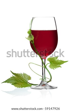 Glass of red wine and grape leaves on a white background and with soft shadow. - stock photo