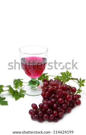 Glass of red  wine and grape on white background