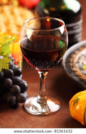 Glass of red wine and grapes for Thanksgiving - stock photo