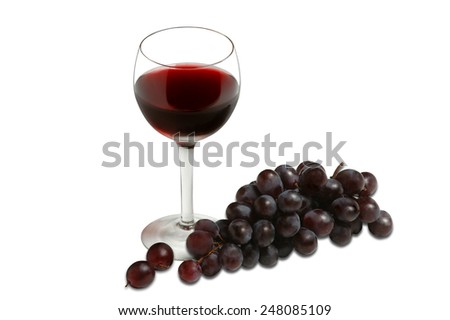 Glass of red wine and grapes on a white background - stock photo