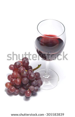 glass of red wine and red grapes - stock photo