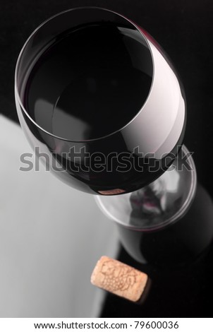 Glass of red wine and wine cork - stock photo