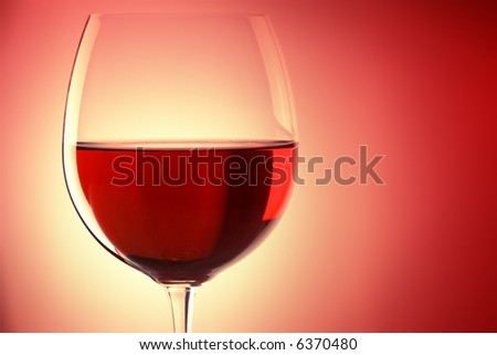 glass of red wine, backlited, with space for text - stock photo
