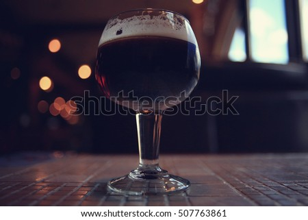 glass of red wine in restaurant interior