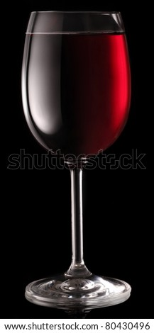 Glass of red wine isolated on a black background. - stock photo