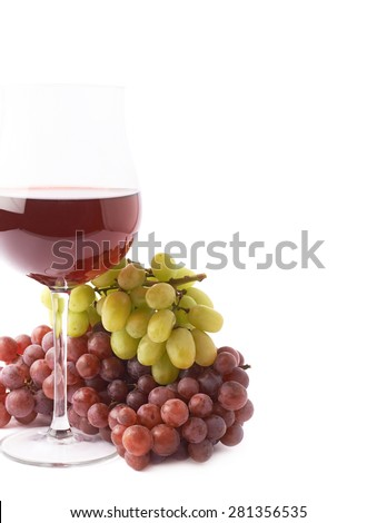 Glass of red wine next to the branches of white and dark red grapes isolated over the white background, framed as a copyspace background composition