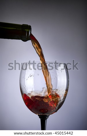 glass of red wine on a  blue background
