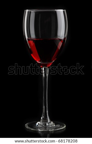 glass of red wine on black background - stock photo
