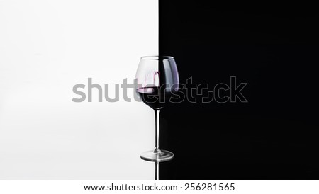 Glass of red wine on black - white background - stock photo