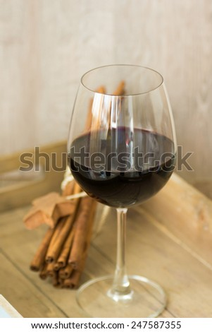 Glass of red wine on the old wooden table