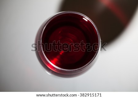 Glass of red wine on wooden table. Top view - stock photo