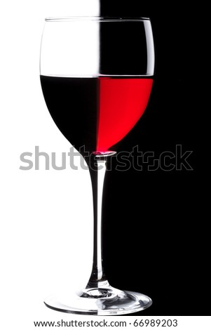 Glass of red wine over black and white background
