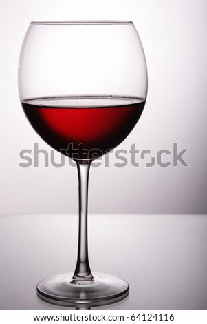 Glass of red wine over light gray white background - stock photo