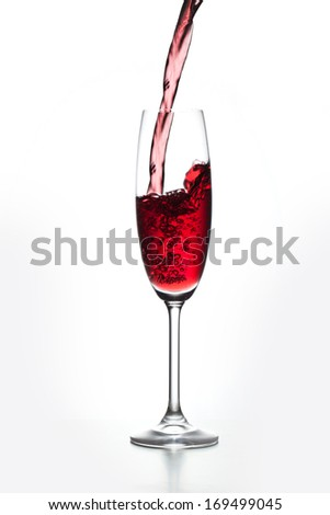 Glass of Red Wine poured out isolated on gray background