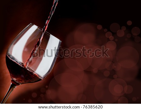 glass of red wine with blur effect - stock photo