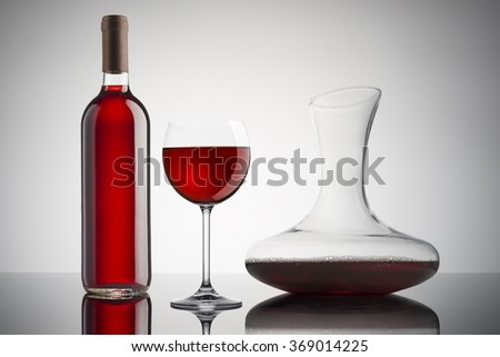 glass of red wine with bottle and decanter - stock photo