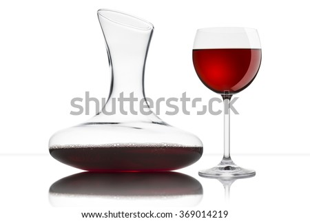 glass of red wine with decanter, on white background