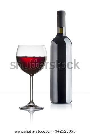 glass of red wine with full bottle on white background - stock photo