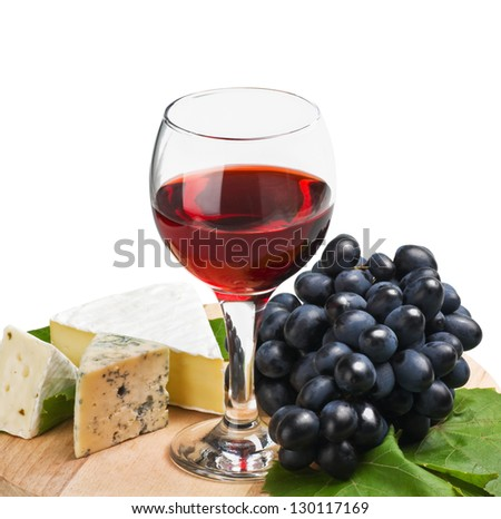 glass of red wine with grapes isolated on white background - stock photo