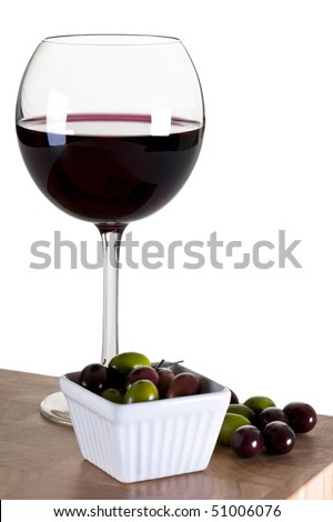 Glass of Red Wine With Olives on a Wooden Board - stock photo