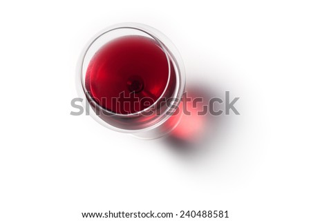 Glass of red wine with shadow.Top view  - stock photo