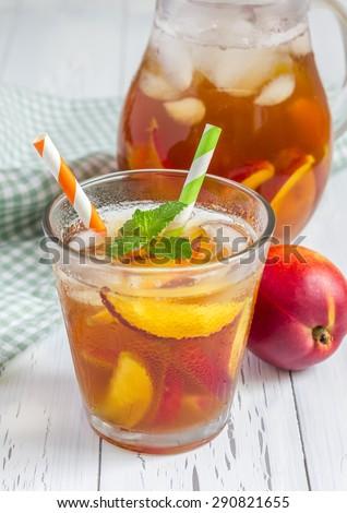 Glass of refreshing homemade peach iced tea - stock photo