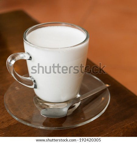 Glass of rich creamy cows milk for a healthy refreshment in a tumbler
