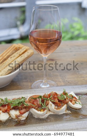 glass of rose and food, rose, wine, appetizer, alcohol, bread sticks, cheese, tomato, mozzarella