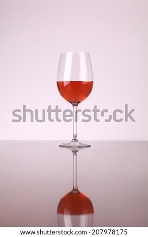 Glass of rose wine over a white background