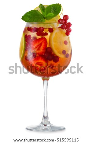 Glass of sangria with fruits and berries isolated on white background