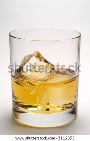 Glass of scotch and ice vertical