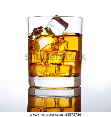 Glass of scotch whiskey and ice.
