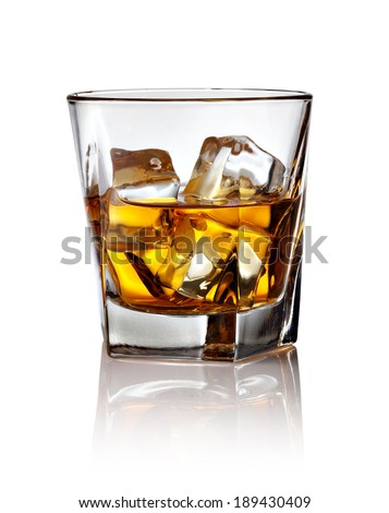 Glass of scotch whiskey and ice on a white background - stock photo