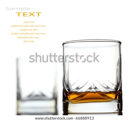 Glass of scotch whiskey isolated over white background and space for your own text - stock photo