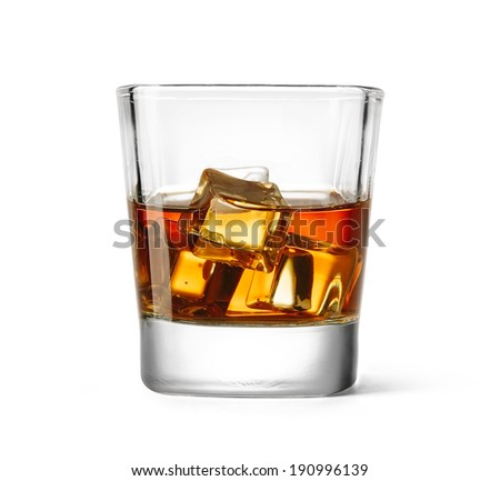 Glass of scotch whiskey with ice on a white background - stock photo