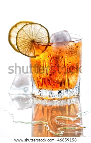 Glass of scotch whisky with lemon and ice on white background - stock photo