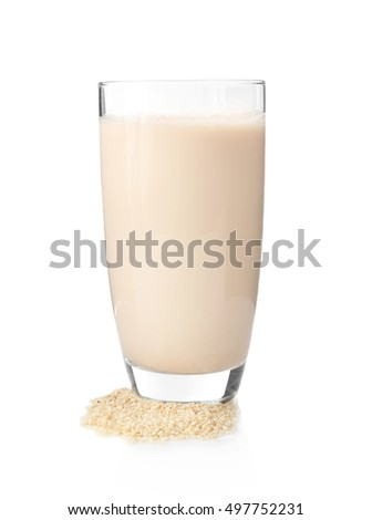 Glass of sesame milk isolated on white
