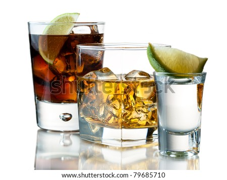 Glass of soda, whiskey on the rocks, tequila shot
