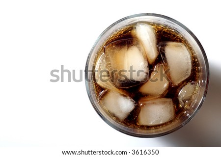 glass of soda with ice from above - stock photo